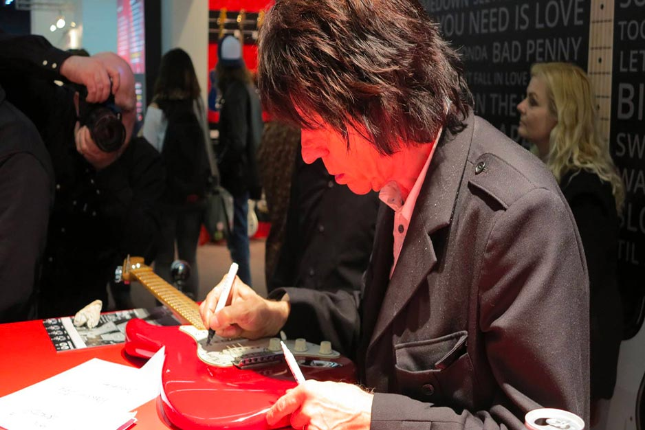 Jeff Beck signing a guitar