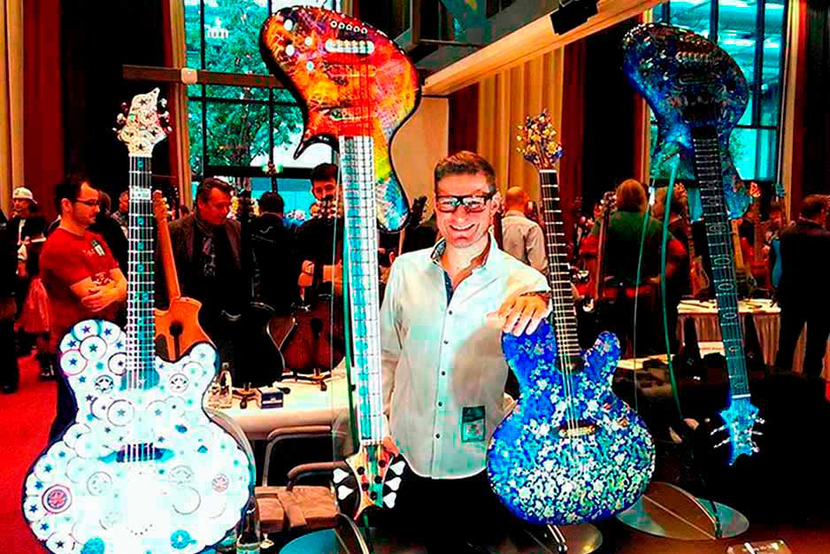 Jenns Ritter with his 4 designed guitars and the Floating Guitar Mini Stand